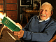 Walter Munk holds a copy of <i>The Rotation of the Earth</i>, a book he co-wr...