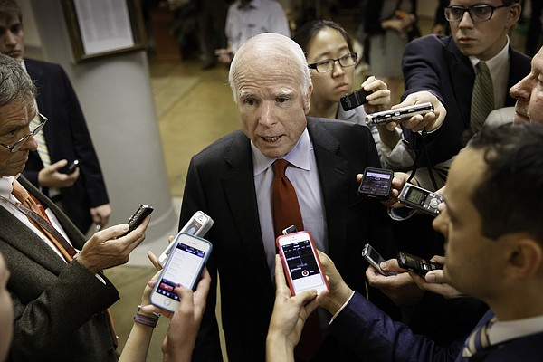 Senate Armed Services Committee member Sen. John McCain, R-Arizona. speaks wi...