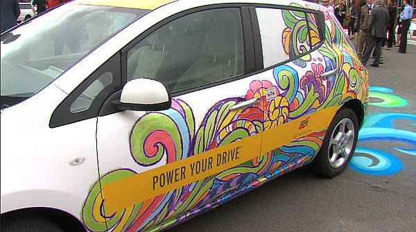 An electric car is seen covered in colorful designs, May ...