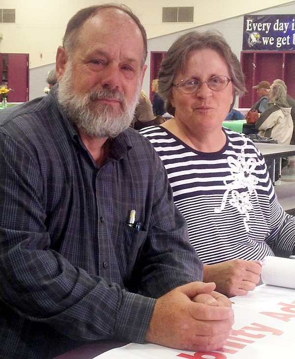 Jim and Becky Cox volunteer with Resources for Independen...