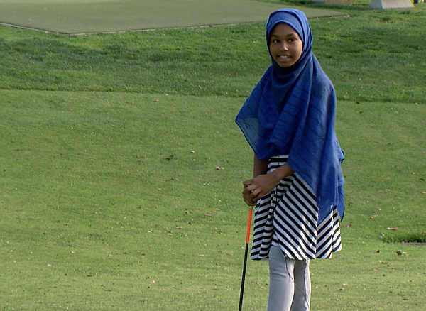 Nasteho Ali learns to play golf at Pro Kids in City Heigh...