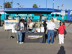 A SANDAG stand at Oceanside Transit Center informs train passengers of coming...