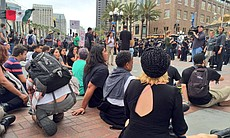 Protesters sit on the ground and refuse to move...