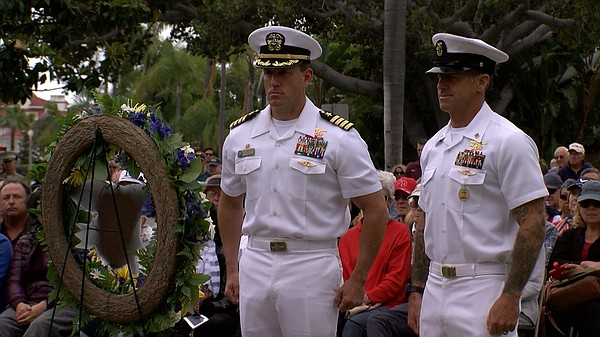 Navy personnel participate in a Memorial Day ceremony in ...