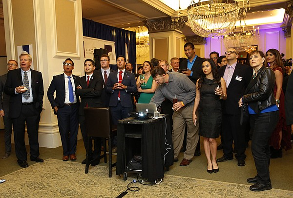 People at the U.S. Grant watch as results come in, June 7...