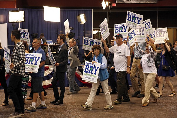 Supporters of Barbara Bry hold signs at Golden Hall in do...