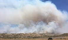 A fast-moving brush fire burns near the Tecate ...