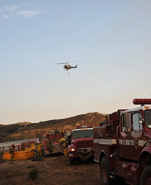 This undated photo shows fire crews assigned to battle th...
