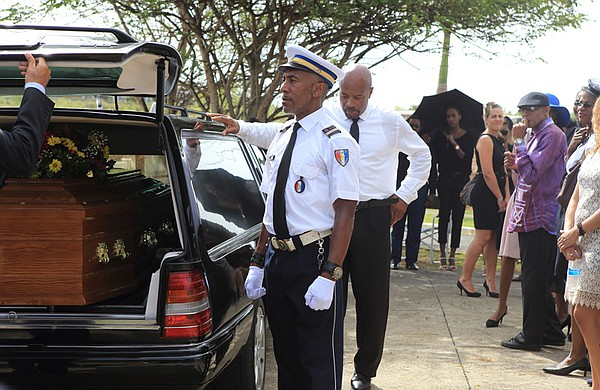 Dwayne Myers (Danny John-Jules) attends his mentor's funeral.