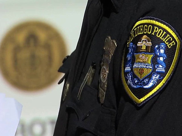 The San Diego Police Department seal is seen on an officer's uniform in this ...