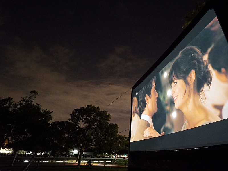A photo of one of Street Food Cinema's outdoor screens. The film series scree...