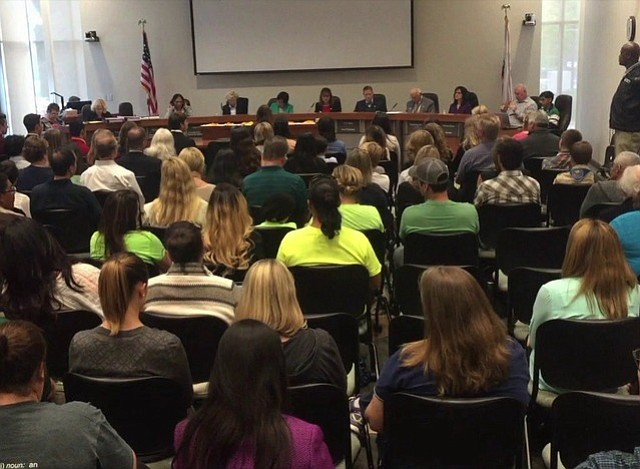 Attendees listen during a Poway Unified School District Board of Education me...