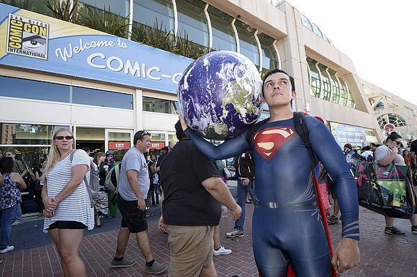 Bersain Gutierrez, dressed as Superman, poses in front of...