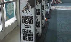 "Promotional signs for ""The Walking Dead"" and ""F..."