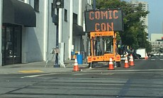 "A street sign reads ""Comic Con"" in downtown San..."