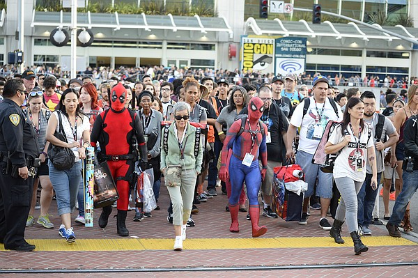 Fans leave the convention center on Day One of Comic-Con International held a...