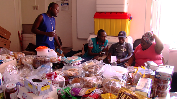 Haitians eat donated food at the United Methodist Christ Ministry Center, Jul...