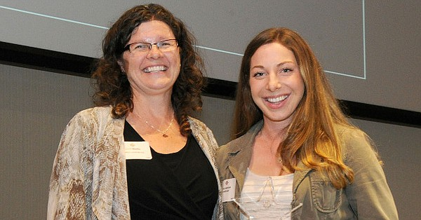 This undated photo shows Jenny Bramer, left, posing with ...