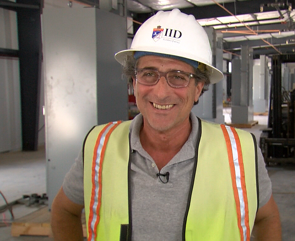 Engineer Bruce Townsend stands inside the building that will house the batter...