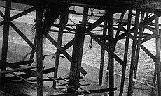 Men work during the construction of the Scripps...