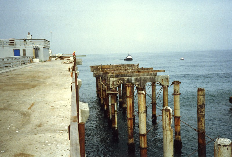 The old Scripps Pier dismantled, right, as the ...