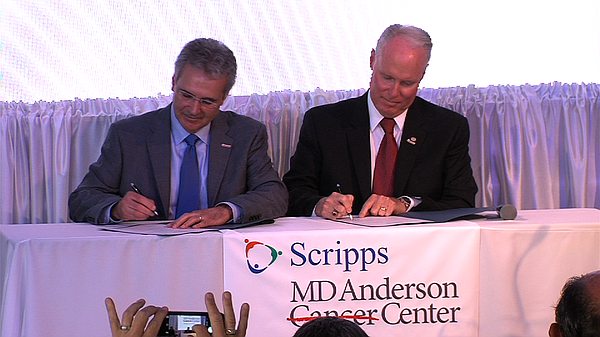 Ronald DePinho (left), president of the MD Anderson Cance...