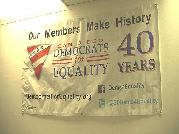 A banner advertising Democrats for Equality hangs on the group's office wall,...