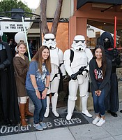 KPBS Major Gifts and Operationa Manager Caitlin Bergin and KPBS Development Coordinator Nereida Martinez with Star Wars characters at Cinema Under the Stars