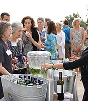 KPBS Producers Club members line up for drinks at the Coastal Roots Farm.