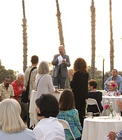KPBS General Manager Tom Karlo welcomes KPBS Producers Club members at the Coastal Roots Farm