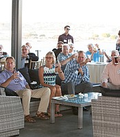KPBS Producers Club members raise their glasses for the new live truck