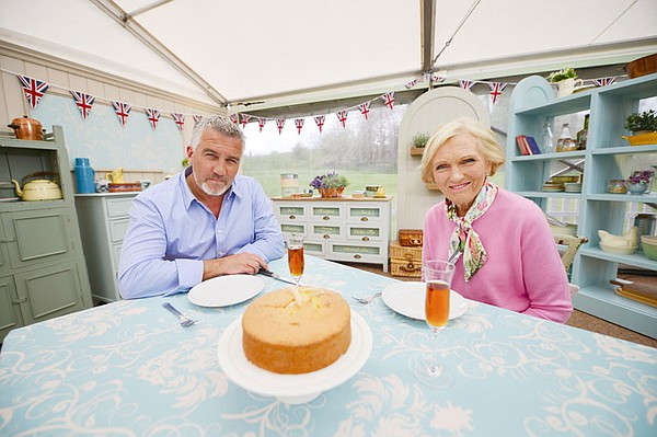 Paul and Mary with Madeira cake and drinks in cake corner.