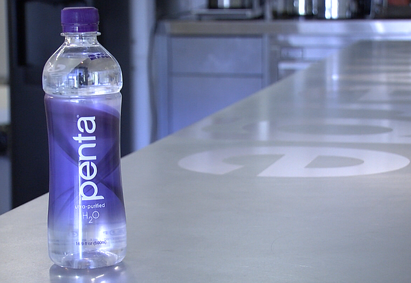 A recently purchased bottle of Penta water is pictured, S...
