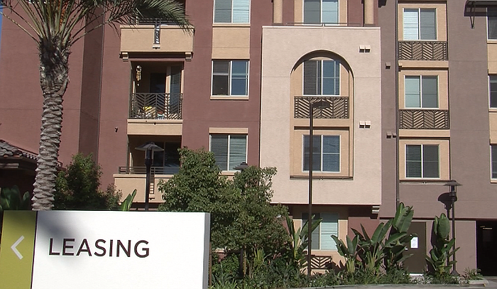 A sign points to the leasing office at the newly-constructed 444-unit Verge