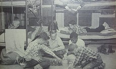 Campers pose by their bunks in this undated photo.