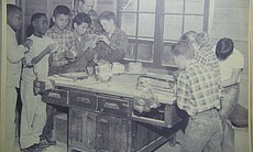 Students work on crafts at sixth grade camp in this undated photo.