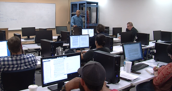 Students listen during a cybersecurity lecture at Coleman...