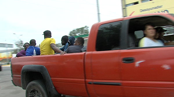 Unknown drivers stop to pick up Haitians and Africans in ...