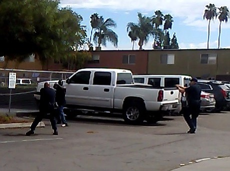 A still image from a cell phone video captured by a witness of two El Cajon police officers shooting an unarmed man, Sept. 27, 2016.