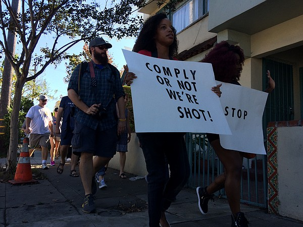 A group of protesters walk through Golden Hill, Oct. 1, 2...