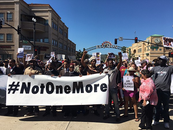 A crowd of several hundred demonstrators march peacefully...