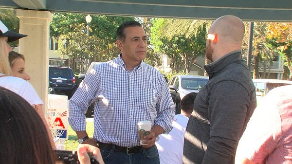 U.S. Rep. Darrell Issa reaches out to volunteers while ca...