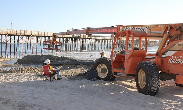 Sand dredged from the mouth of the Oceanside harbor is fe...