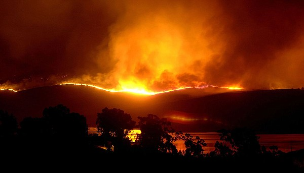 The Harris fire, that blackened 90,440 acres east of Chula Vista, burns along...