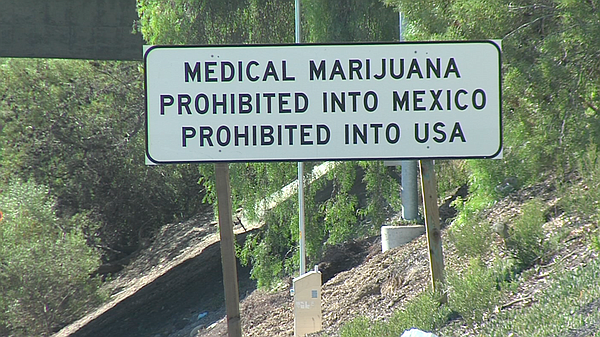 A sign on the southbound Interstate 5 warns against smugg...