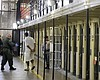 A condemned inmate is led out of his east block...