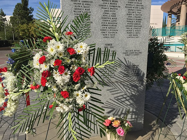 Wreaths decorate a memorial dedicated to Aztecs who have ...
