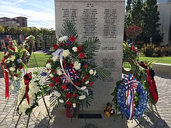 Wreaths decorate a memorial dedicated to Aztecs who have died while serving i...