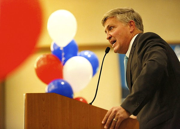 San Diego County Supervisor Dave Roberts speaks to suppor...