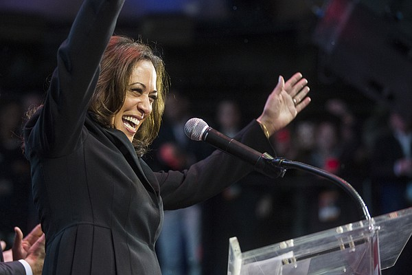 Kamala Harris greets a crowd in Los Angeles before giving...